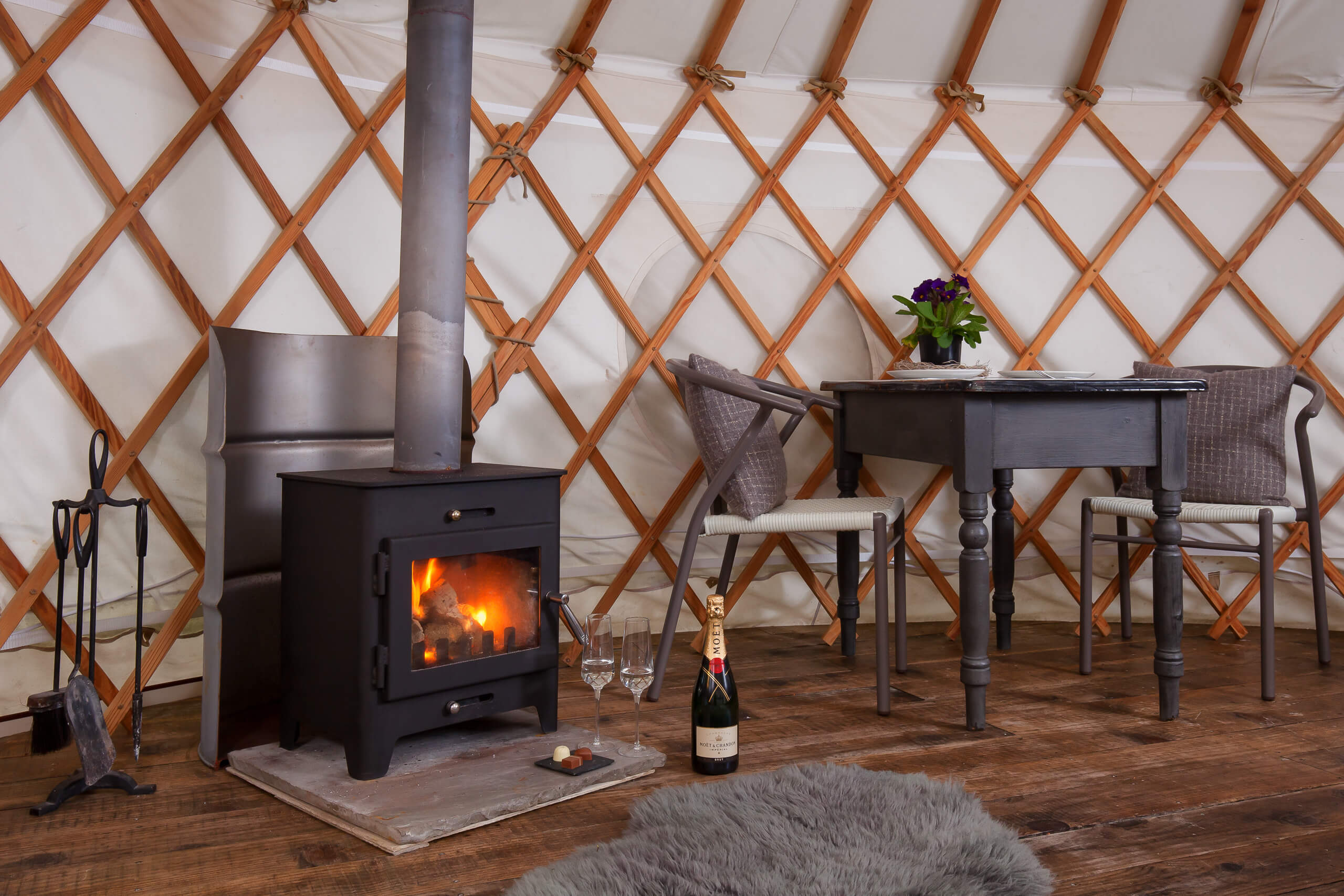 Yurt interior, glamping, The Yurt Retreat, champagne by the fire, Holidays Uk